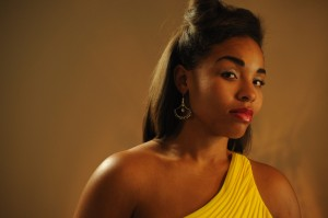 Beautiful young black girl in an evening gown.