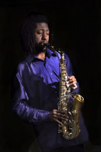 Young saxophone player in the spotlight.